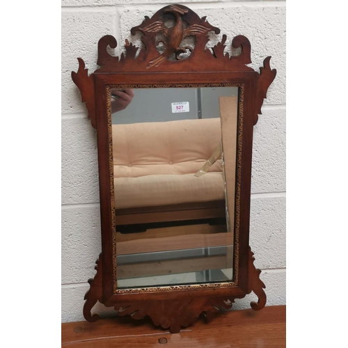 528 - A large bevelled edge wall mirror