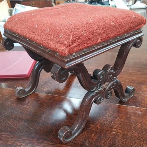 531 - A 19th century mahogany 'X' framed stool on knurled supports