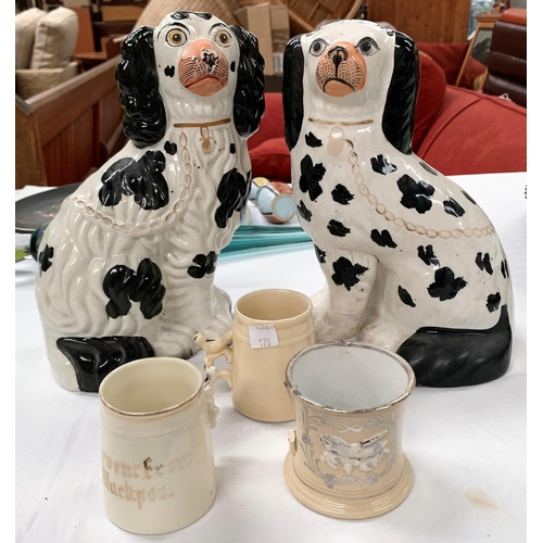 170 - A matched pair of King Charles spaniels; 2 whistle mugs and another...