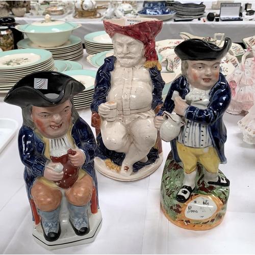 182 - Three English pottery toby jugs, 9.5