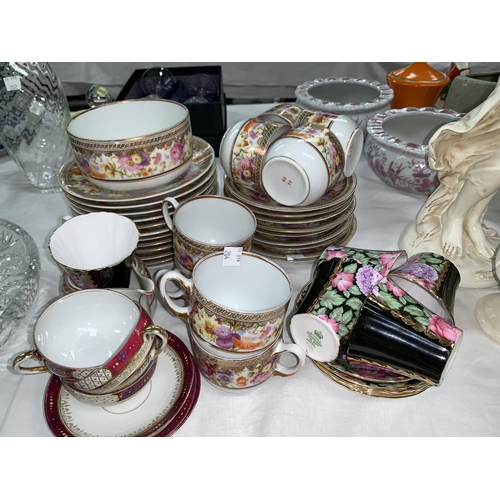 204 - A continental 32 piece part tea service with wide gilt polychrome floral border; 10 pieces of Royal ...