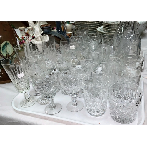 210 - A selection of various cut glass drinking glasses; a decanter with silver rim and another decanter...