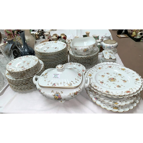 211 - A continental Limoges style large dinner service:  soup tureen and bowls; meat plates; dinner and si...