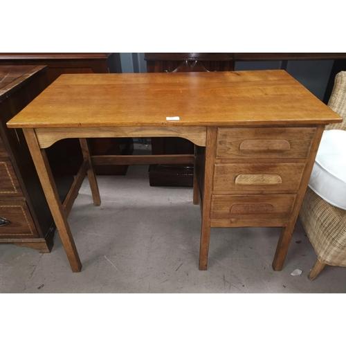 507 - A 1930's oak kneehole desk with single pedestal...