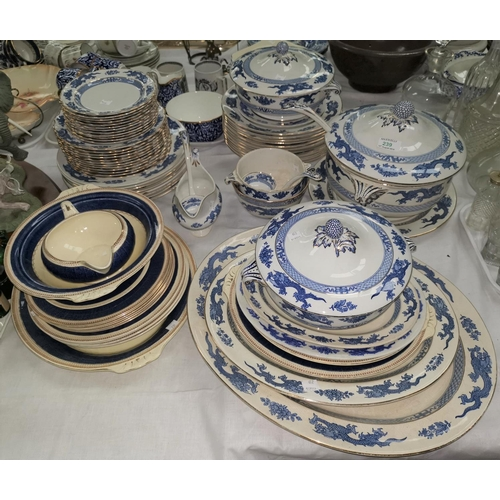 239 - A Booths Dragon pattern blue and white part dinner service; A 1920'S WHITE PAINTED WOVEN CANE ARMCHA...