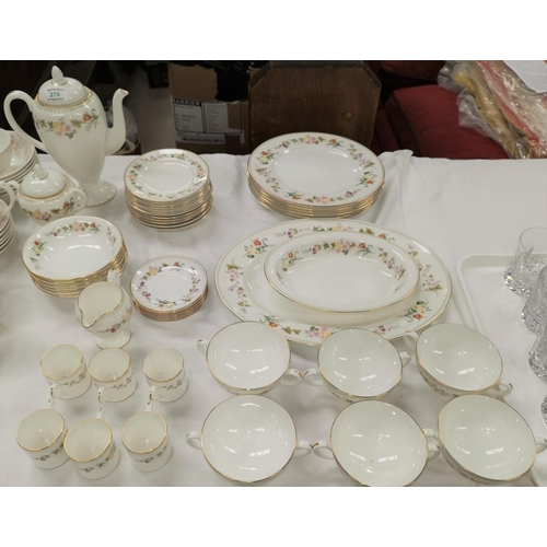 270 - A large Wedgwood Mirabelle part dinner and tea service with floral decoration and gilt borders...