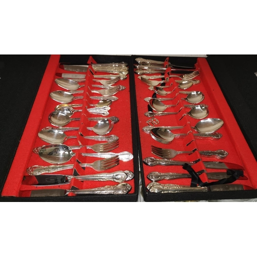 306 - A pair of boxed sets of Falstaff silver plated cutlery, other silver plate and 2 large brass plaques...