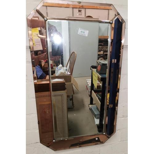 416 - A wall mirror in Art Deco peach frame...
