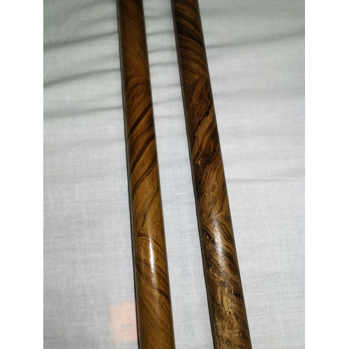 432 - Two 19th century faux grain wood novelty sticks...