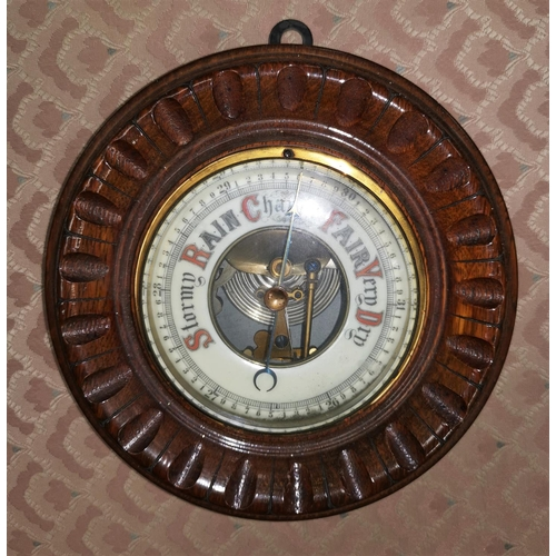 450A - A mahogany cased aneroid barometer...