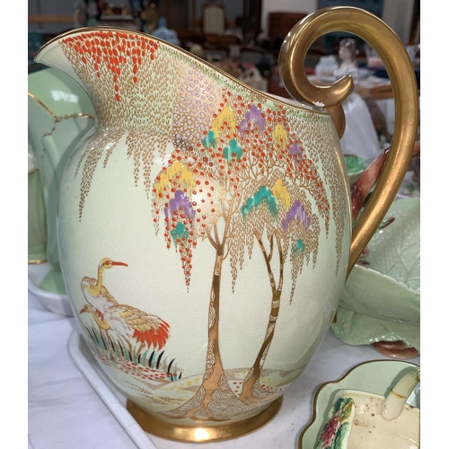 185 - A Carltonware Art Deco ovoid jug with jewelled and gilt decoration of storks and trees; a Carlton pa...