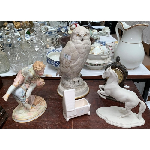 171 - A china Snowy Owl - Raymond watson for the Franklin Mint; a bisque group, 2 boys playing leap frog e...