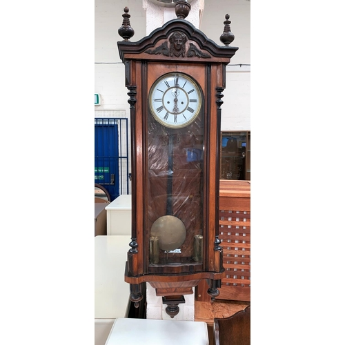 391 - A 19th century walnut Vienna wall clock with ebonised and turned mouldings etc, white dial and doubl...
