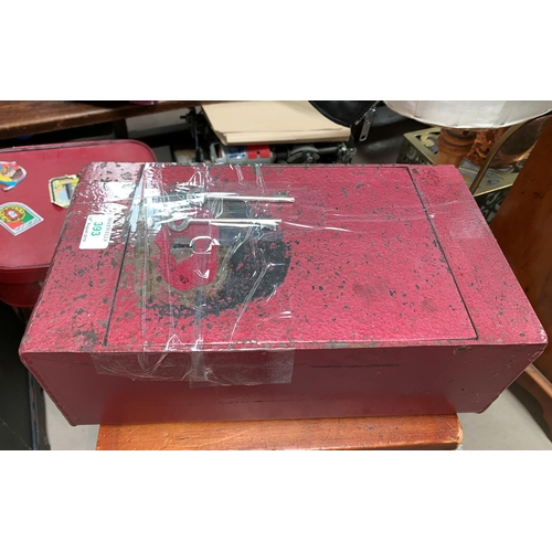 393 - A cast metal strong box with key...