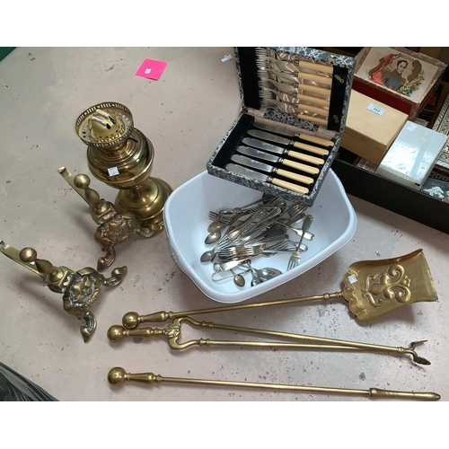 411 - A Victorian style set of 3 brass fire irons and dogs; a brass oil lamp; a fish canteen, cased; silve...