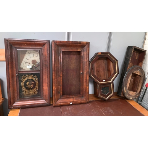 387 - A 19th century American wall clock in mahogany rectangular case, with movement and dial (incomplete)...