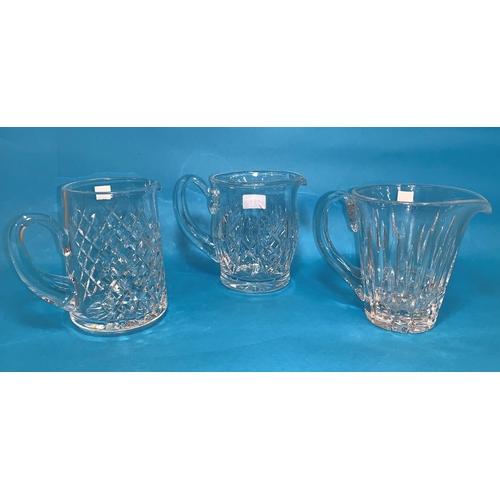 154 - Three  Waterford Crystal water jugs, heights 6