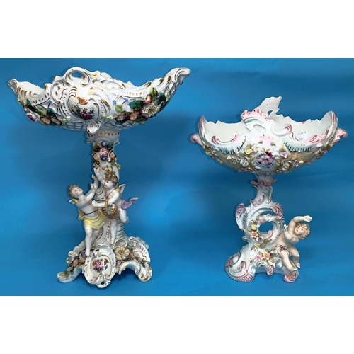 164 - A Dresden style large encrusted table centre decorated with 2 cherubs, height 14