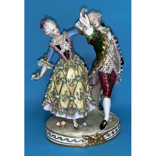 165 - A Dresden style encrusted group of 2 dancing figures in 18th century dress, height 9