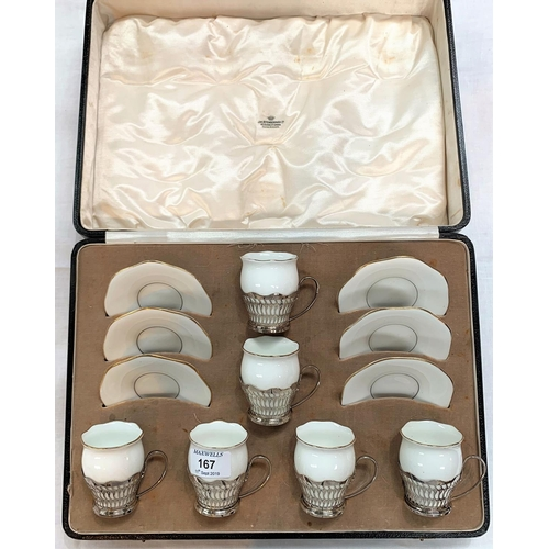167 - A Coalport boxed set of 6 white porcelain coffee cups in pierced silver holders, Birmingham 1942...