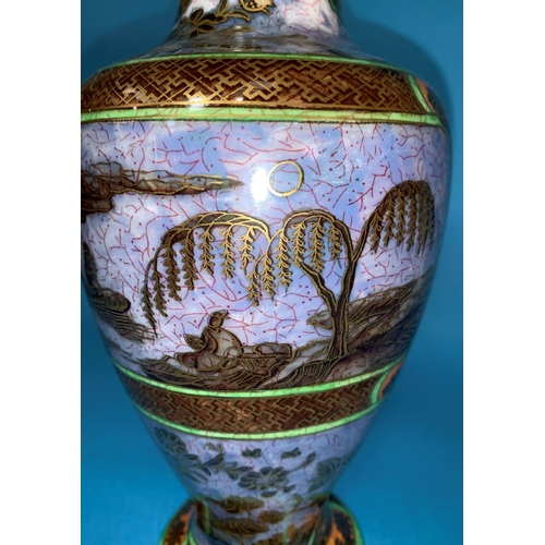 186 - A 1930's Wedgwood lustre baluster vase decorated with chinoiserie scenes of a man in a boat, with tr...