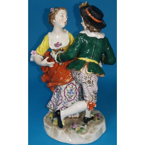 196 - A 19th century porcelain group in the Derby manor depicting a young man and woman in 18th century cl...