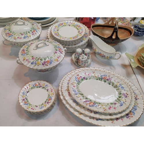 179 - A Royal Doulton ' Easter Morn' dinner service including tureens, meat plates etc...
