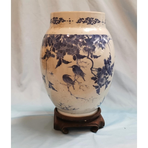 239a - A 19th century Chinese blue & white ovoid decorated with birds in flowering branches, height 10