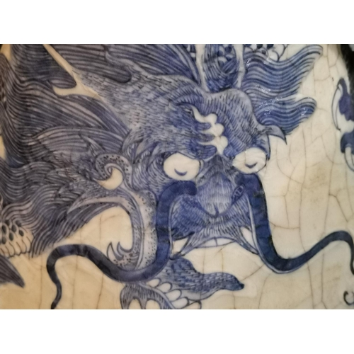 258d - A Chinese pair of large crackle glaze vases decorated in blue with dragons, impressed seal to bases,...