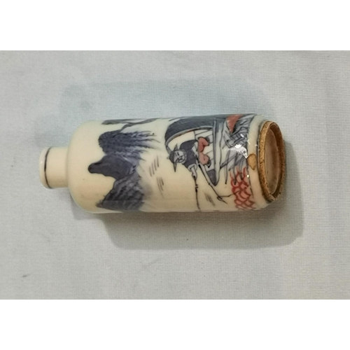 261 - A Chinese porcelain cylindrical  snuff bottle decorated in underglaze blue and red with a pastoral f...