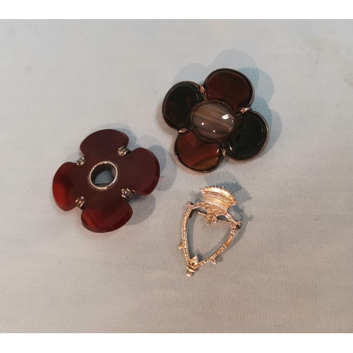 331 - A 19th century Scottish polished agate brooch with silver mount; a similar brooch; an Iona brooch...