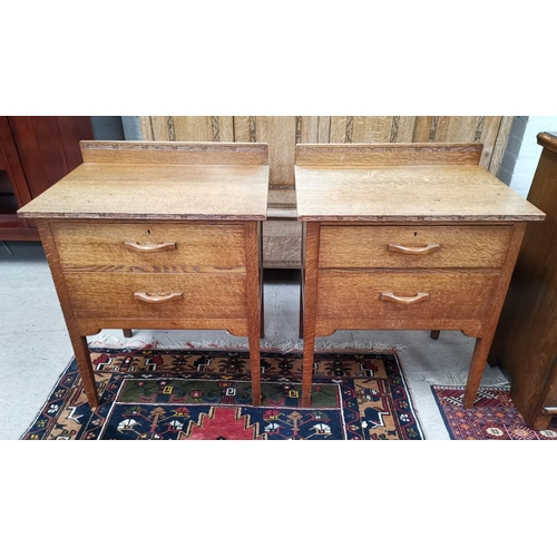 547A - A similar pair of Arts and Crafts oak bedside cabinets, with two drawers....
