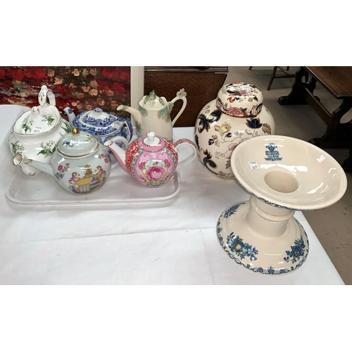 167A - A German porcelain teapot in the form of an 18th century Chinese armorial pot; four decorative teapo...