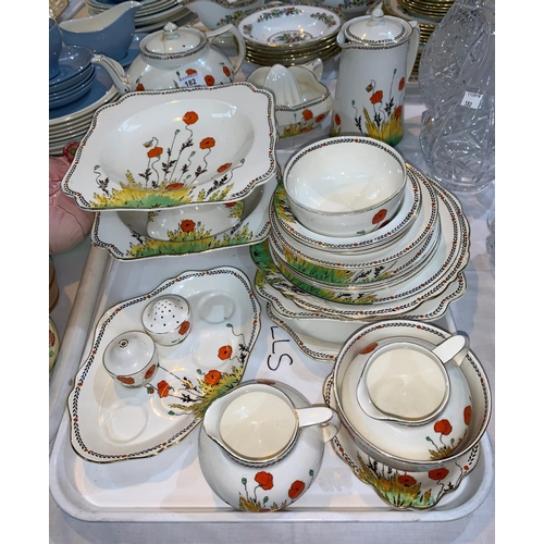 182 - A Crown Ducal Art Deco period part dinner and tea  service decorated with poppies...