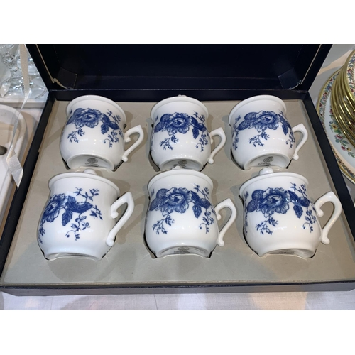 183 - A set of 6 Royal Worcester porcelain chocolate pots and matching tray, boxed. A Cranberry claret jug...