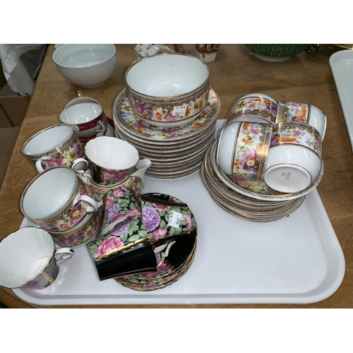 182C - A continental 32 piece part tea service with wide gilt polychrome floral border; 10 pieces of Royal ...