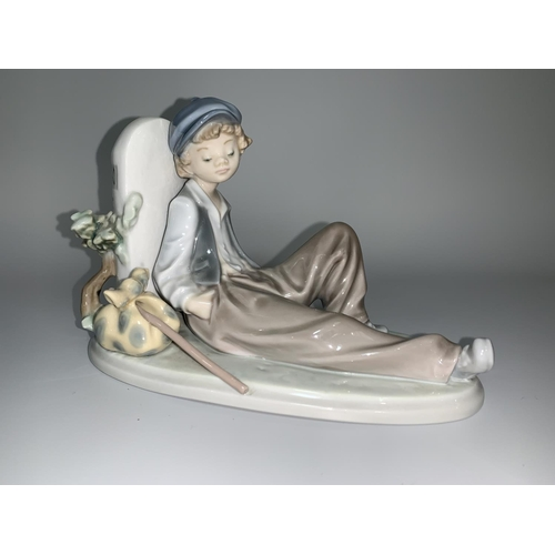 6 - A Lladro figure - young boy with knap sack leaning against a signpost 'N340'...