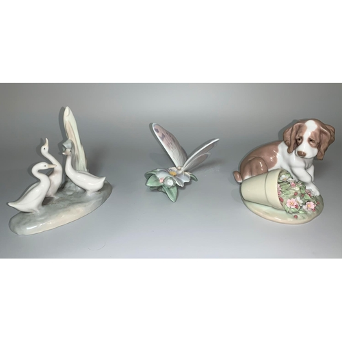 8 - A Lladro group of 3 geese; a Lladro figure of a Spaniel and knocked over plant pot of flowers; a Lla...