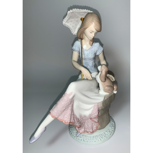 9 - A Lladro figure of a seated girl holding a parasol and a puppy, 5th Anniversary, impressed '7612'...