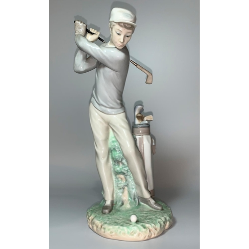 10 - A Lladro figure of a young man swinging a golf club with bag of clubs beside hi, height 28cm...
