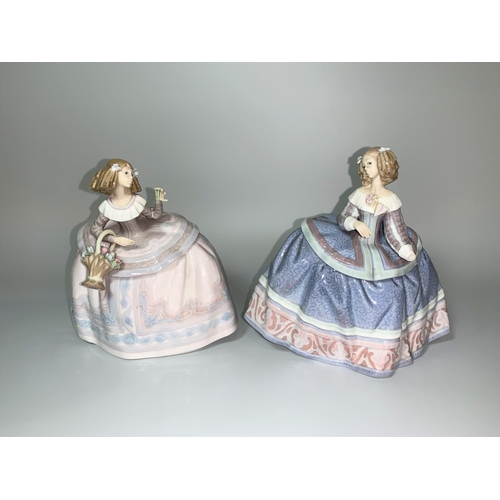 13 - Two Lladro ladies in crinolines, one holding a basket of flowers (a.f.)...