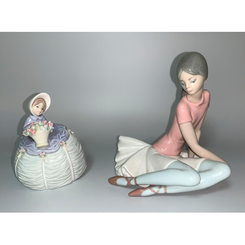 14 - Two Lladro figures - ballerina seated on floor, in pink top and a small Lladro crinoline lady with a...