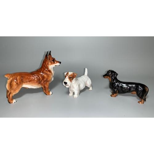 156 - A Royal Doulton Scottish Terrier medium HN1031, a Dachshund HN1129 and a Welsh Corgi HN2558...