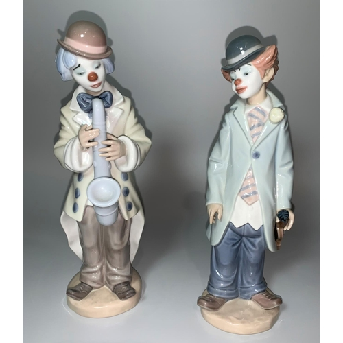 17 - Two Lladro figures - boy clown with saxophone, another holding a violin (impressed 5471 and 5472)...