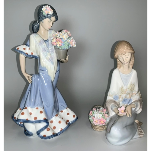 19 - A Lladro figure of A Spanish girl with flowers; a Lladro figure of a seated girl with basket of flow...