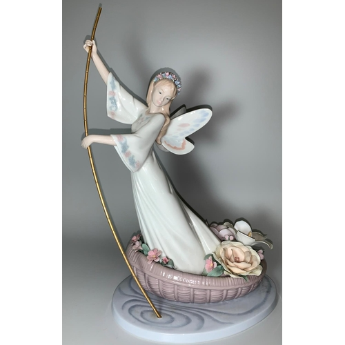 24 - A large Lladro figure of a fairy in small boat with flowers, ht 37cm...