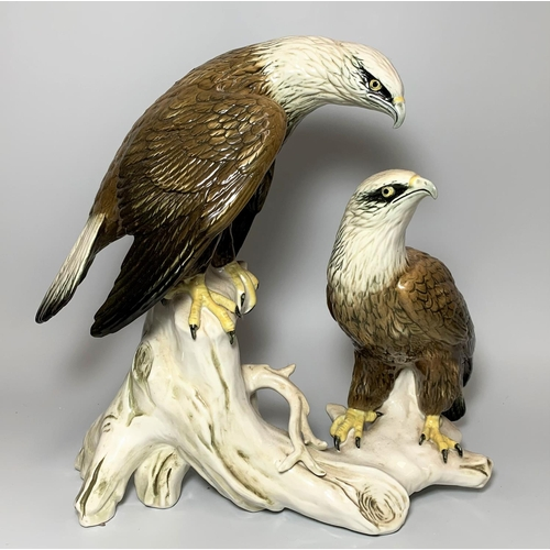 43 - A large continental china group pair of eagles on a branch height 13.5