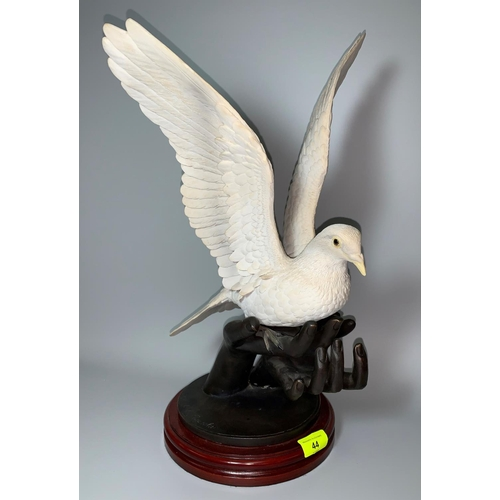 44 - Jose de Casasola bronze & resin group hands holding a dove with outstretched wings, Ltd Edition 382/...