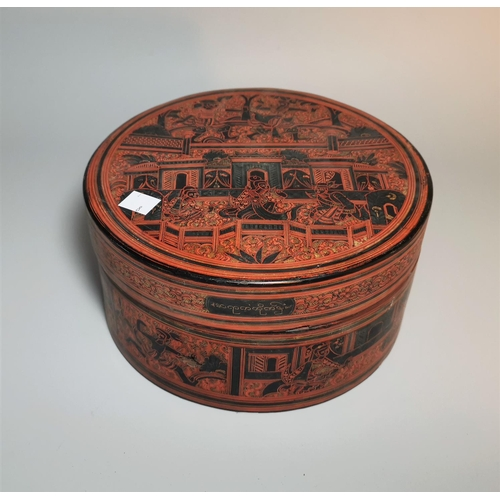122 - A 19th century Burmese red lacquer circular box and cover, with figural decoration on black ground, ...
