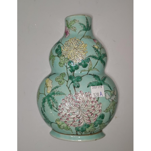 128a - A Chinese porcelain double gourd shaped wall vase decorated with chrysanthemums on pale blue ground,...